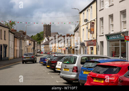 UK, Wales, Carmarthenshire, Carmarthen, Lammas Street, with tower of St David's Church - Stock Photo