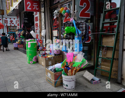 MISHAN, CHINA - JULY 27, 2019: Different stuffs for sale. Mishan is a county-level city in the southeast of Heilongjiang Province. - Stock Photo