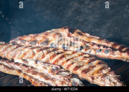 Barbecue grill with grilled pork ribs. Spanish churrasco - Stock Photo