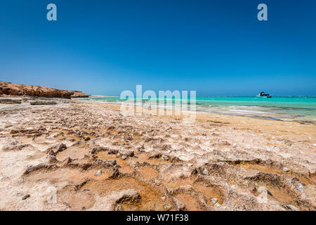 Rough tidal zone along Coral Bay Walk Way in Australia - Stock Photo