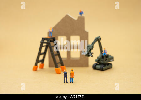 Miniature people Construction worker repair A model house model  using as background real estate concept and repair concept with copy space for your t - Stock Photo