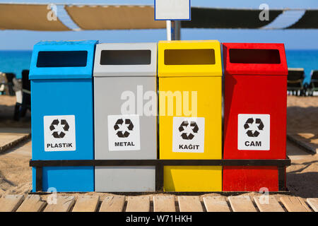 Tanks containers of different colors for separate collection of waste and garbage on the sea beach. - Stock Photo