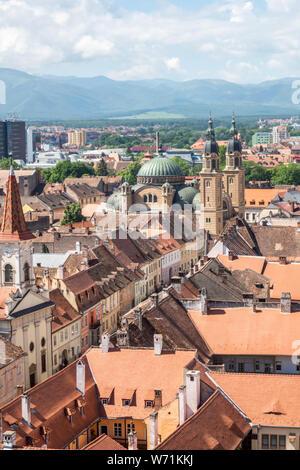 Sibiu panorama, centered on Strada Mitropoliei. The Orthodox Cathedral, Casa Altemberger, Reformed Church, Carpathians. Sibiu, Transylvania, Romania - Stock Photo