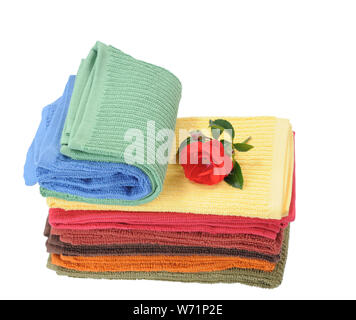 colorful towels and rose flower isolated on white - Stock Photo