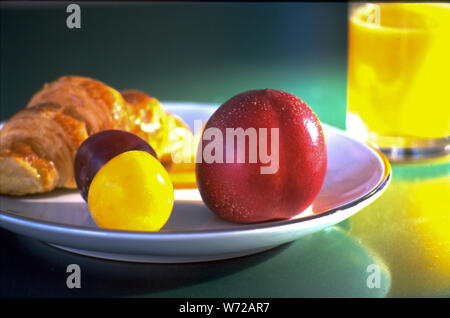 The French keep their breakfast light. Bread, being the staple, orange juice, fruits and occasional cheeses are some of the choices. - Stock Photo