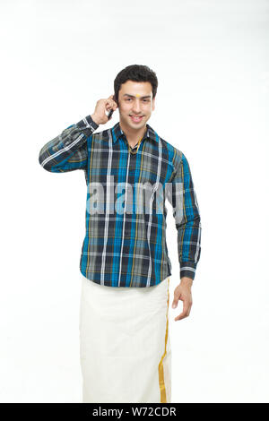 South Indian man talking on mobile phone
