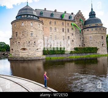 Örebro Castle.  A medieval castle fortification in Örebro, Närke, Sweden. Art installation by Filthy Luker & Pedro Estrellas 'Octopus Attacks!' - Stock Photo