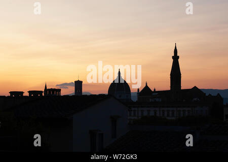 View of Florence sihouettes of landmarks from top view at sunset in Italy. Santa Maria del Fiore in the evening