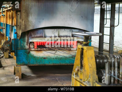 Rolled wire production at the metallurgical plant. - Stock Photo