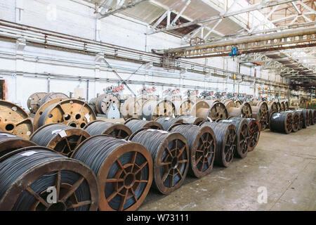 Wire rod, fittings in warehouses. industrial storehouse at the metallurgical plant. - Stock Photo