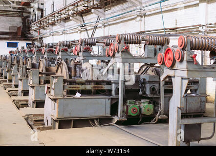 Rolled wire production at the metallurgical plant - Stock Photo