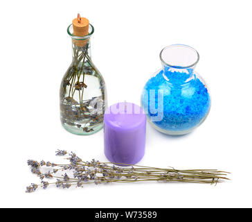 lavender water, salt and aromatic candle isolated on white background - Stock Photo