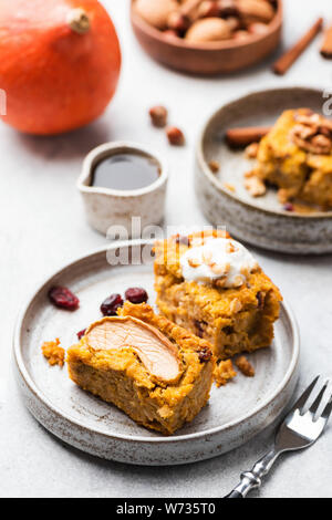 Breakfast Pumpkin Apple Pie With Cranberries On Plate Topped With Cream Walnuts And Maple Syrup. Selective Focus - Stock Photo