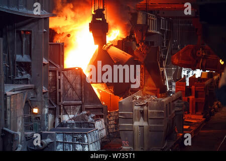 smelting of the metal in the foundry, metallurgical industry. - Stock Photo