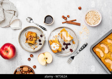Breakfast Pumpkin Apple Tray Cake Or Pie With Cinnamon, Walnuts And Dried Cranberry. Table Top View On Grey Concrete Background. Thanksgiving Breakfas - Stock Photo