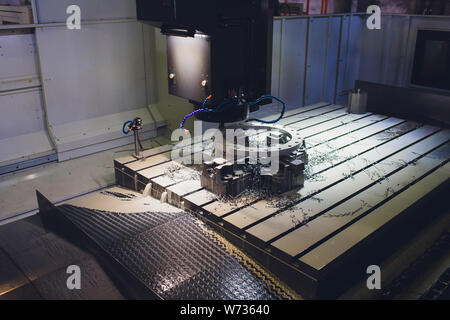 Worker male hands working with CNC machine at factory with lathes. - Stock Photo