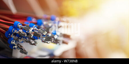 Bundle of crimped cables with electrical connectors. Terminated wire ready to creation connection. Industrial background with copy space for text - Stock Photo
