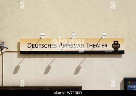 Bad Homburg, Germany - June 09, 2019: Wall lights cast shadows on a sign of the German Appelwoi Theater on June 09, 2019 in Bad Homburg. - Stock Photo