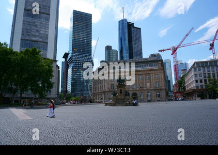 Frankfurt, Germany - July 06, 2019: The Rossmarkt with pedestrians and passers-by at the Johannes-Gutenberg-monument with fountain on July 06, 2019 in - Stock Photo