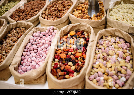 Mix nuts,healthy vegan food. Dry fruits in Bulk Bags on the market. Natural grains. - Stock Photo