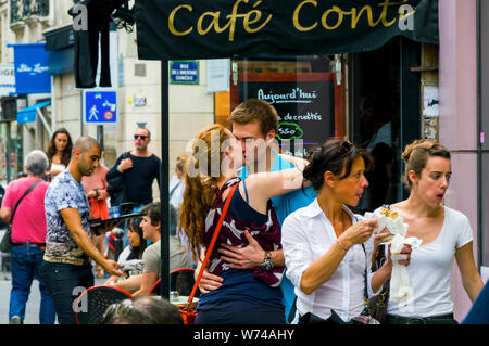 Happy young beautiful couple kissing and smiling on the street. France, Paris, October, 04, 2014 - Stock Photo