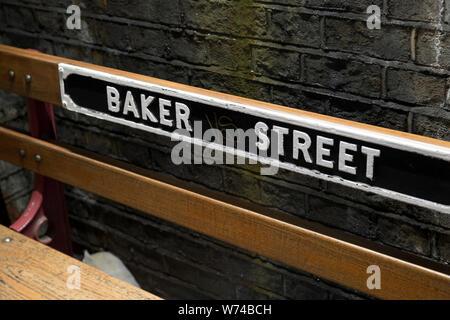 Baker Street Underground Station, Wooden Bench with Tube Station Sign, London, England, UK - Stock Photo