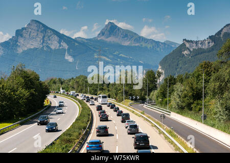 Maienfeld, GR / Switzerland - 4. August 2019: traffic jam on a highway in the mountains with many cars and people returning home from summer holidays - Stock Photo