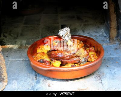 Kleftiko, traditional cretan dish consisting of lamb with potatoes in the oven. - Stock Photo