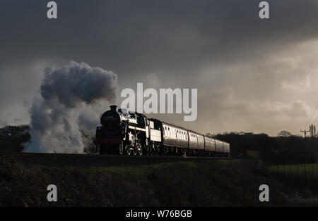 BR standard 4mt No.76084 is seen at Burrs on the East Lancashire Railway - Stock Photo
