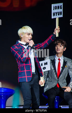 South Korean singer-songwriter Kim Jong-hyun, left, better known as Jonghyun, and other members of South Korean boy group SHINee interact with fans at - Stock Photo