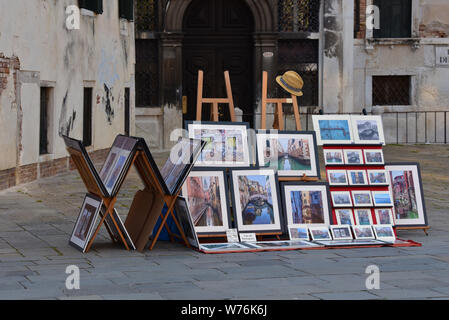 Venetian art for sale, displayed in a quiet corner of St Mark's Square, Venice, Veneto, Italy, Europe. - Stock Photo