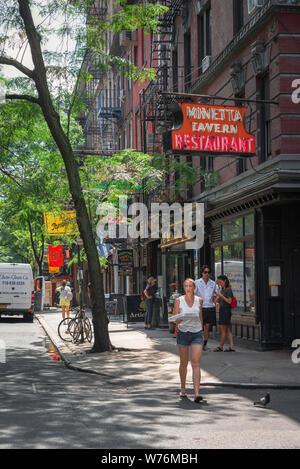 Greenwich Village, view in summer of MacDougal Street in the center of Greenwich Village (West Village), Manhattan, New York City, USA - Stock Photo