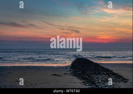 sand beach sunset view in island norderney, travel Germany - Stock Photo
