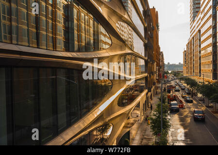 Manhattan architecture, view at sunset along West 28th Street in Chelsea with facade of 520 West 28th Street building by Zaha Hadid on left, New York. - Stock Photo
