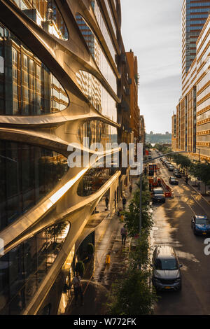 New York architecture, view at sunset along West 28th Street in Chelsea with facade of 520 West 28th Street building by Zaha Hadid on left, New York. - Stock Photo