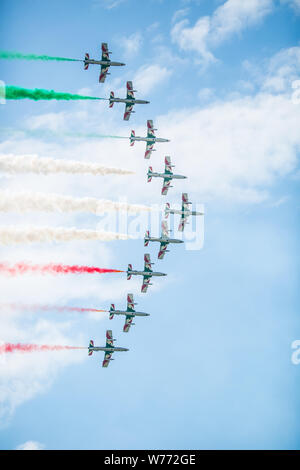 Sliac,Slovakia - August 4, 2019. Air shov Italian aerobatic squadron Frecce Tricolori on the sky show off acrobatic maneuvers. - Stock Photo
