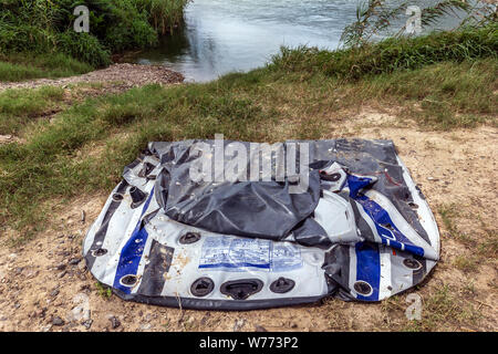 Discarded rafts used by migrants to cross the Rio Grande River, found on the USA side in Roma, Texas, USA - Stock Photo