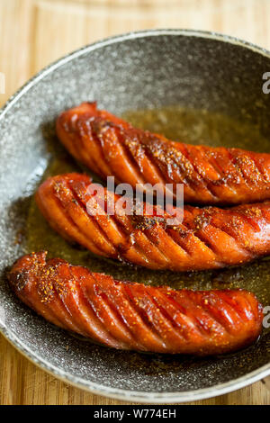 Grilled sausages fried on pan - Stock Photo