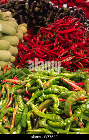 Useful fresh vegetables are sold at the local farmers' market: eggplant, red pepper and zucchini. A variety of organic ingredients. Vegan or diet food - Stock Photo