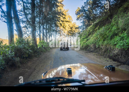 View from the inside of an offroad car riding down the road at the Bromo Tengger Semeru National Park on the Java Island, Indonesia. One of the most - Stock Photo