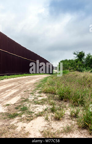 A portion of the high steel border fence, Brownsville, Texas, USA. - Stock Photo