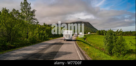VR Caravan car travels on the highway. Tourism vacation and traveling. Beautiful Nature Norway natural landscape.