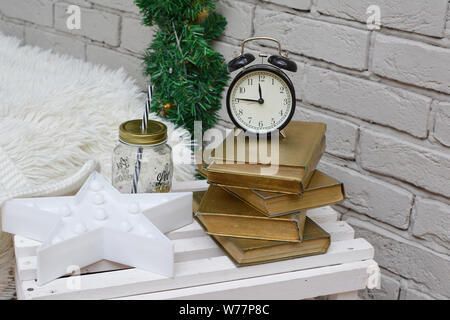 Vintage alarm clock in traditional study room showing fifteen to midnight. Happy New Year!