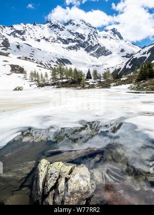 Mountains get reflected in lake Maessersee, Binn valley, Valais, Switzerland - Stock Photo