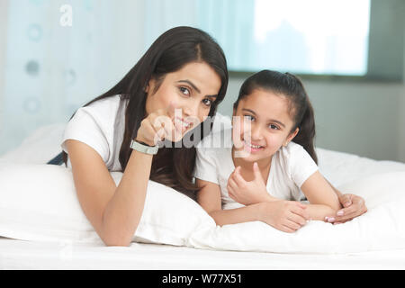 Mother showing something to her daughter