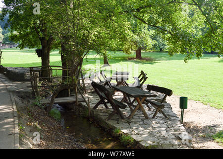 Wooden picnic table in park. - Stock Photo