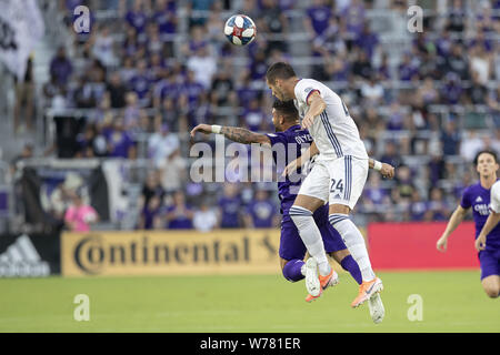 August 3, 2019, Orlando, Florida, U.S.A: FC Dallas defense MATT HEDGES (24) and  Orlando City forward DOM DWYER (14) go after a header at the MLS game at Exploria Stadium in Orlando. Florida. (Credit Image: © Cory Knowlton/ZUMA Wire) - Stock Photo
