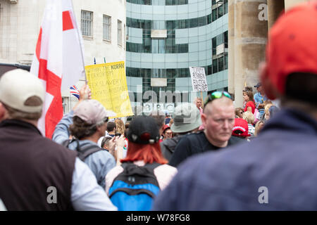 London, UK. 3rd August 2019. Tommy Robinson supporters hold a rally near Oxford Circus in front of the BBC, and demand his release from prison, serving time for contempt of court reporting on the Huddersfield grooming gang during their trial. Credit: Joe Kuis / Alamy News - Stock Photo
