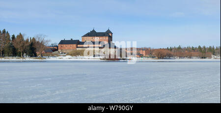 Panorama of Vanajavesi lake overlooking the ancient fortress of the Hameenlinna sity  on a March morning. Finland - Stock Photo