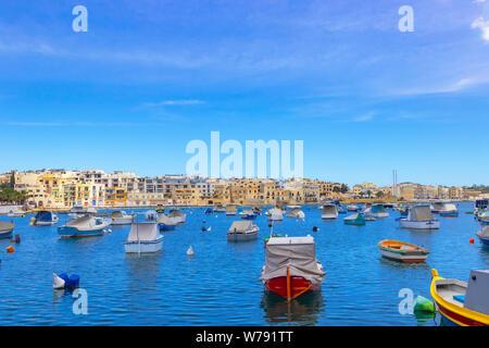 View of a seaside promenade in Birzebbuga and St Georges Bay, Malta - Stock Photo